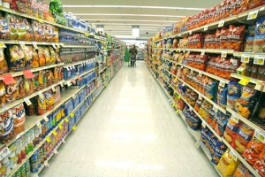 Long-grocery-store-aisle-shelves-filled-with-products.