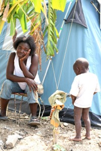 haitian-boy-peeing-beside-tent