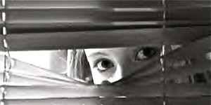 woman_peeking_through_blinds
