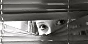 woman_peeking_through_blinds