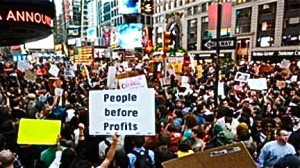 crowd-of-protesters-with-sign-people-before-profits