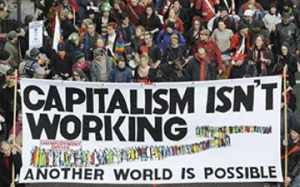 protestors-with-capitalism-isn't-working-sign