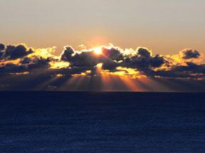 sun-behind-dark-clouds
