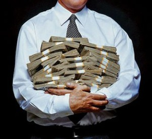 banker-holding-armful-of-money