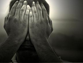 hiding behind-hands-in-fear