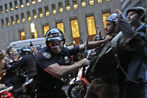 occupy-wall-street-police-with-baton