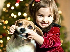 little-girl-pulling-dog's-mouth-into-a-smile