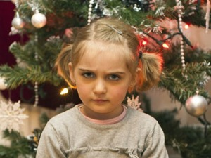stressed-girl-with-christmas-tree