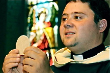 priest-holding-eucharist