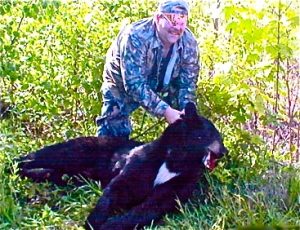 hunter-with-slain-bear