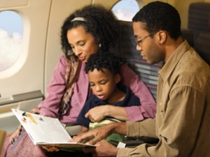 family-seated-together-on-plane